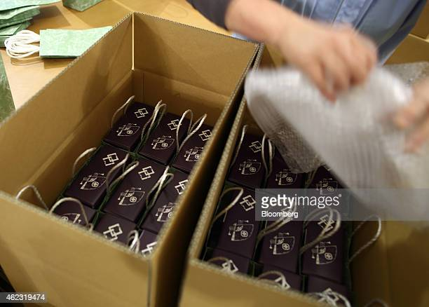 A Yagisawa Shouten Co employee arranges packaged bottles of soy sauce into cartons at the company's factory in Ichinoseki Iwate prefecture Japan on...
