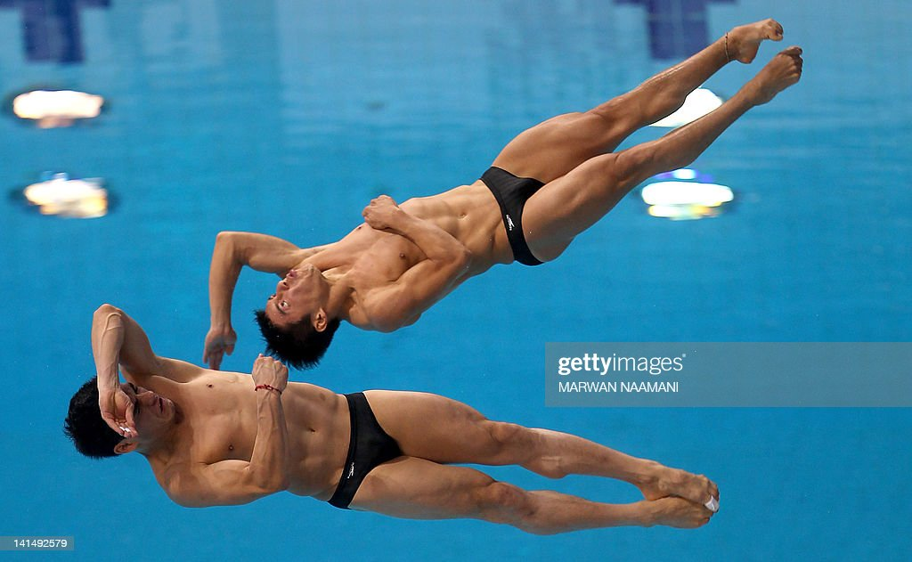 Yahel Castillo and Daniel Alejandro Islas of Mexico, winners of second place in men's 3m synchronised Springboard compete in the final of the International Swimming Federation (FINA) Diving World Series at the Hamdan bin Mohammed bin Rashid al-Maktoum sports complex in the Gulf emirate of Dubai on March 17, 2012.
