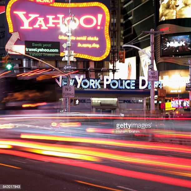 Yahoo and New York Police Department neon signs at Times Square Manhattan New York USA
