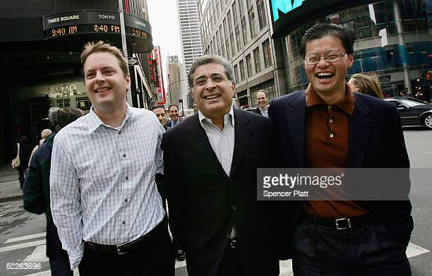 Yahoo cofounders David Filo and Jerry Yang pose with company chief executive Terry Semel in Times Square after ringing the opening bell at the NASDAQ...