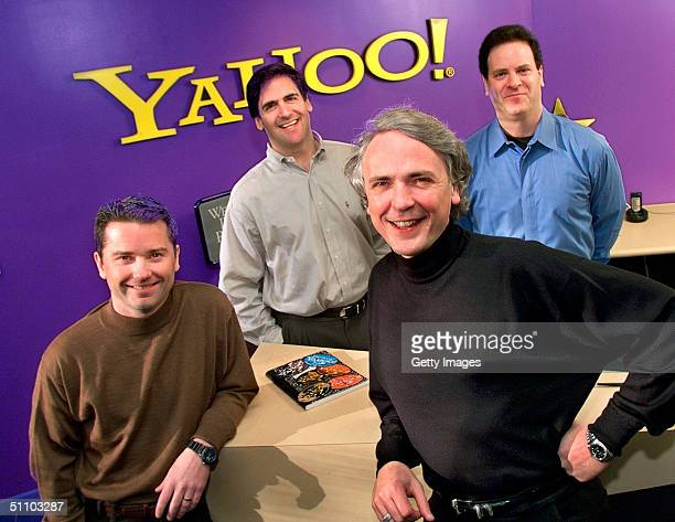 Yahoo Inc Executives Front Jeff Mallett President And Coo And Tim Koogle Chairman And Ceo And BroadcastCom Inc Executives Rear Mark Cuban President...