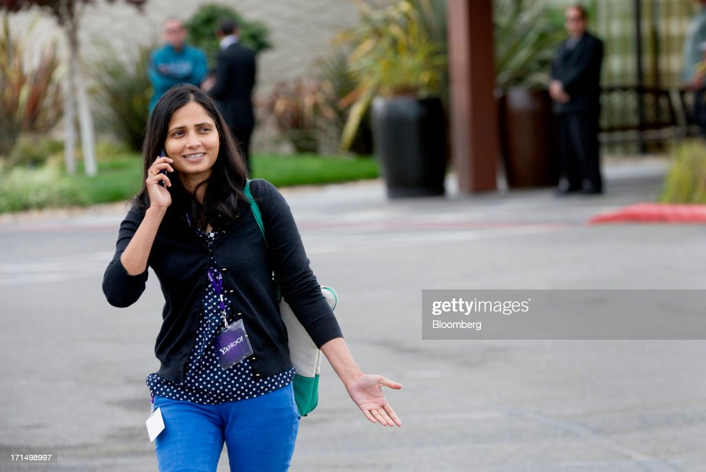 A Yahoo! Inc. shareholder talks on the phone while leaving the annual meeting in Santa Clara, California, U.S., on Tuesday, June 25, 2013. Yahoo! Inc. Chief Executive Officer Marissa Mayer, in her first annual meeting with shareholders, said the biggest U.S. Web portal is making headway in efforts to attract shutterbugs and users of mobile devices. Photographer: David Paul Morris/Bloomberg via Getty Images