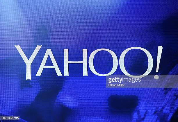 Yahoo logo is shown on a screen during a keynote address by Yahoo President and CEO Marissa Mayer at the 2014 International CES at The Las Vegas...