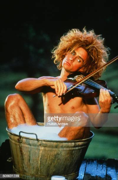 Yahoo Serious plays a violin in a scene from the Warner Bros movie 'Young Einstein' circa 1988