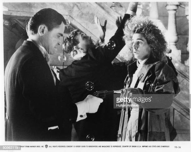 Yahoo Serious plugs a gun in a scene from the Warner Bros movie 'Young Einstein' circa 1988