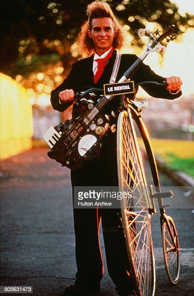 Yahoo Serious poses with a antique bike for the Warner Bros movie 'Young Einstein' circa 1988