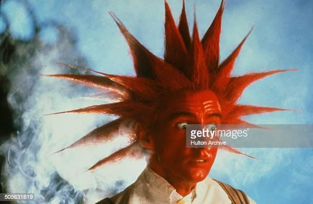 Yahoo Serious turns orange in a scene from the Warner Bros movie 'Young Einstein' circa 1988