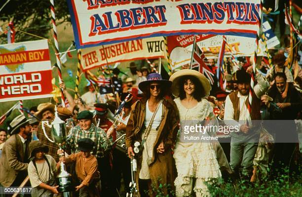 Yahoo Serious walks with Odile Le Clezio in a scene from the Warner Bros movie 'Young Einstein' circa 1988
