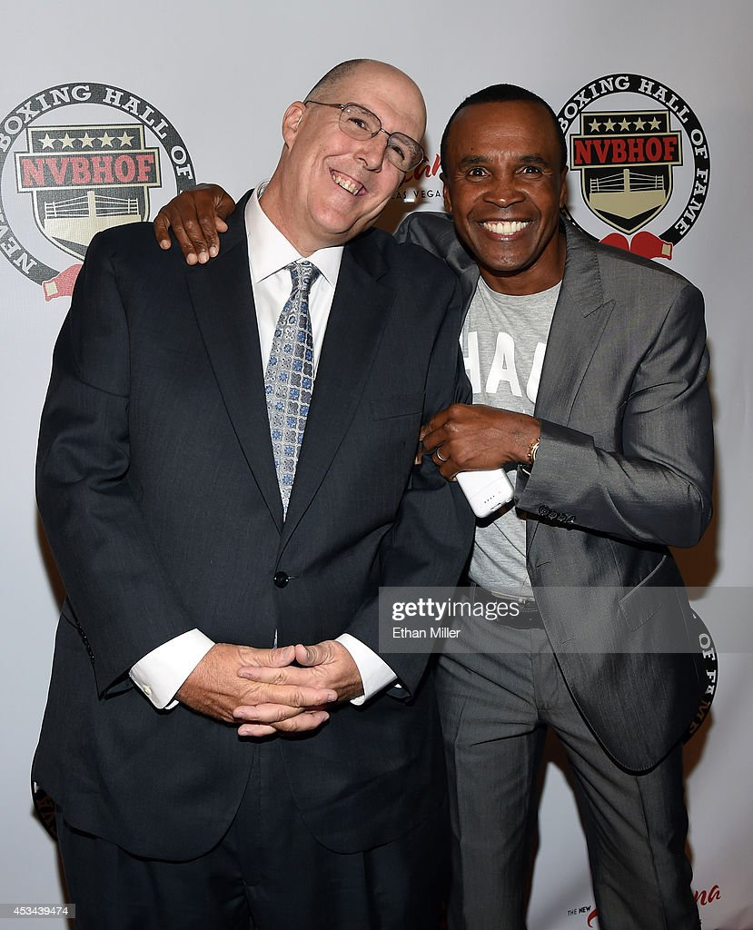 Yahoo! Sports writer and inductee Kevin Iole (L) and former boxer Sugar Ray Leonard arrive at the second annual Nevada Boxing Hall of Fame induction gala at the New Tropicana Las Vegas on August 9, 2014 in Las Vegas, Nevada.