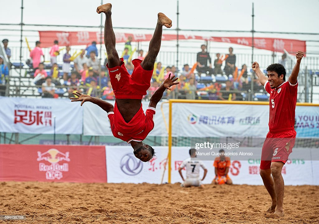 Yahya Al Araimi (L) of Oman celebrates scoring with his teammate Mandhar Hilal during the Continental Beach Soccer Tournament match between Oman and Lebanon at Municipal Sports Center on August 23, 2016 in Ordos of Inner Mongolia Autonomous Region, China.