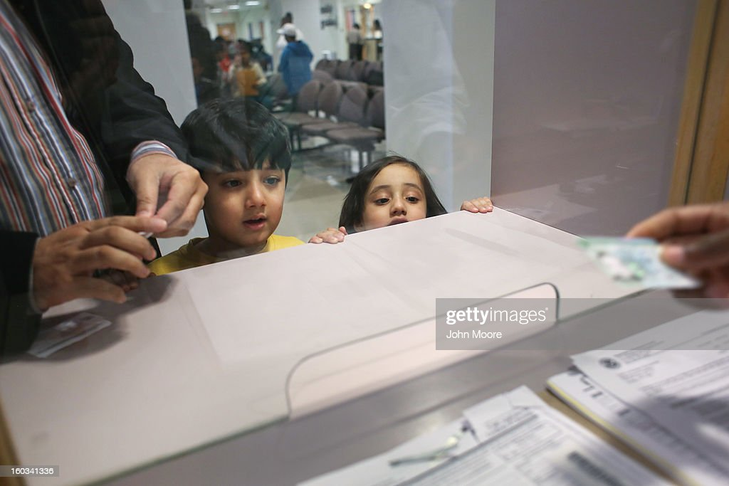 Yahya Chaudhary, 5, and his sister Malaika, 3, stand with her father Musrrat Chaudhary, who immigrated to the U.S. from Pakistan, during an interview at the U.S. Citizenship and Immigration Services (USCIS), district office on January 29, 2013 in New York City. Some 118,000 immigrants applied for U.S. citizenship and 2,500 children received citizenship certificates in the New York City dictrict in 2012. Although underage children of naturalized immigrants usually receive U.S. citizenship, they must go through a process at the USCIS in order to receive legal certificates. Children born in the United States are American, regardless of the immigrant status of their parents.