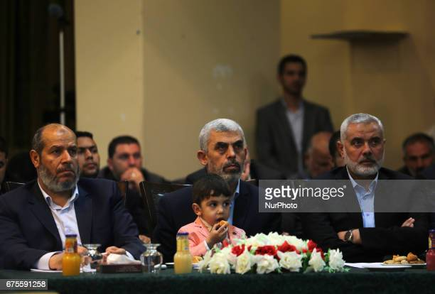 Yahya Sinwar the new leader of the Hamas Islamist movement in the Gaza Strip and senior political leader Ismail Haniyeh attend a gathering to watch...