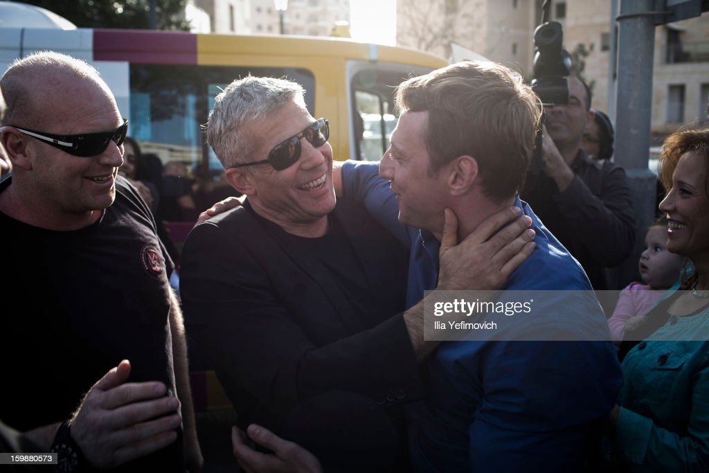 Yair Lapid, chairman of 'Yesh Atid' party meets a supporter as he visits a polling station to cast his vote in the Israeli General Election on January 22, 2013 in Netania, Israel. The latest opinion polls suggest that current Prime Minister Benjamin Netanyahu will return to office, albeit with a reduced majority.