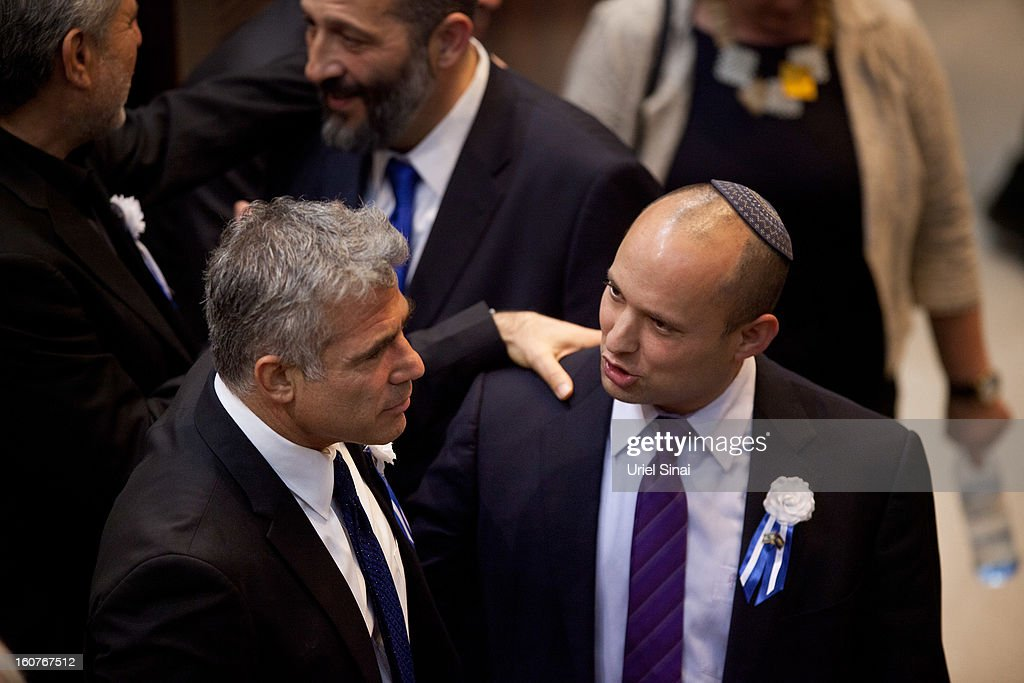 Yair Lapid leader of the Israeli Yesh Atid party (L) and Naftali Bennett, head of Israel's Jewish Home party attend the swearing-in ceremony of the 19th Knesset, the new Israeli parliament, on February 5, 2013 in Jerusalem, Israel. The 120 members included a record 48 new law makers.