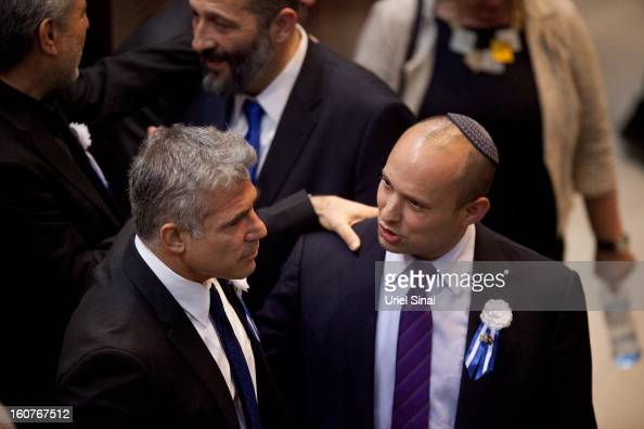 Yair Lapid leader of the Israeli Yesh Atid party and Naftali Bennett head of Israel's Jewish Home party attend the swearingin ceremony of the 19th...