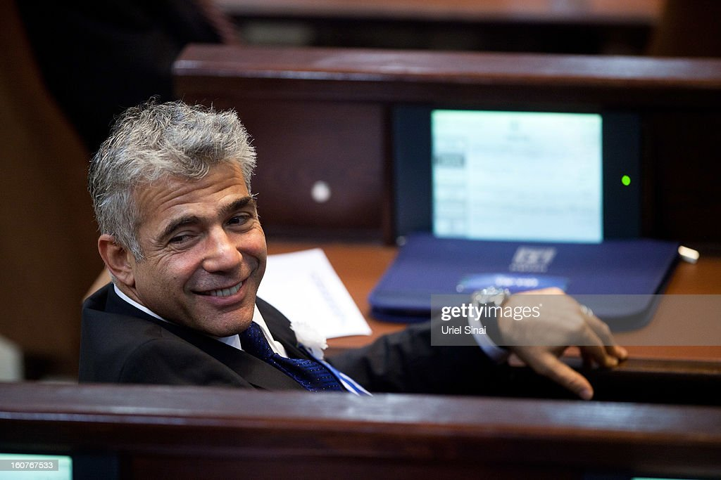 Yair Lapid leader of the Israeli Yesh Atid party attends the swearing-in ceremony of the 19th Knesset, the new Israeli parliament, on February 5, 2013 in Jerusalem, Israel. The 120 members included a record 48 new law makers.