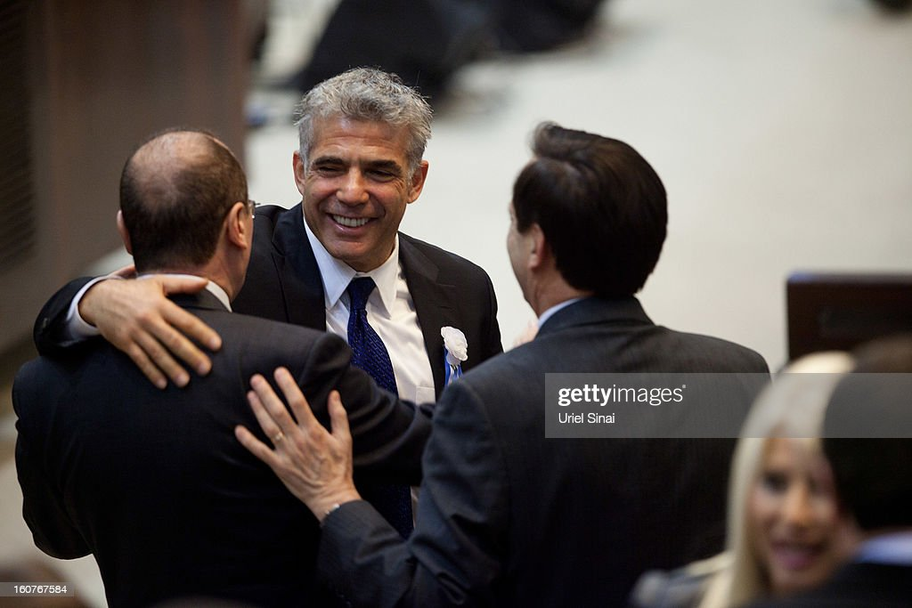 <a gi-track='captionPersonalityLinkClicked' href=/galleries/search?phrase=Yair+Lapid&family=editorial&specificpeople=5366792 ng-click='$event.stopPropagation()'>Yair Lapid</a> leader of the Israeli Yesh Atid party attends the swearing-in ceremony of the 19th Knesset, the new Israeli parliament, on February 5, 2013 in Jerusalem, Israel. The 120 members included a record 48 new law makers.