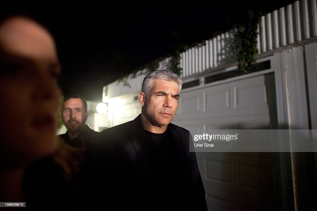 Yair Lapid, leader of the Yesh Atid party, comes out of his house to speak to the press following his unexpectedly strong showing in this week's elections on January 23, 2013 in Tel Aviv, Israel. The Israeli actor, journalist, author, former TV presenter and news anchor won 19 of 120 parliamentary seats and is expected to form a coalition government with incumbent prime minister Binyamin Netanyahu.