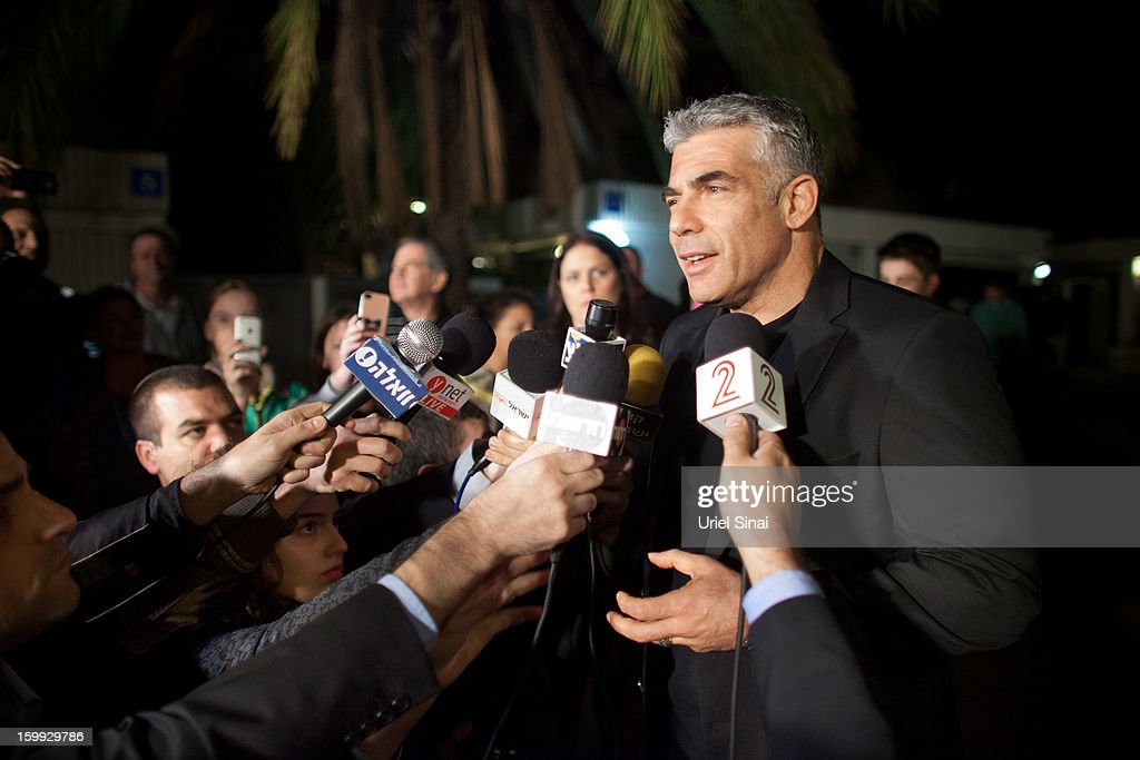 Yair Lapid, leader of the Yesh Atid party, speaks to members of the press outside his house following his unexpectedly strong showing in this week's elections on January 23, 2013 in Tel Aviv, Israel. The Israeli actor, journalist, author, former TV presenter and news anchor won 19 of 120 parliamentary seats and is expected to form a coalition government with incumbent prime minister Binyamin Netanyahu.