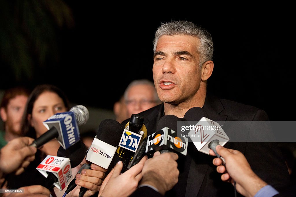 <a gi-track='captionPersonalityLinkClicked' href=/galleries/search?phrase=Yair+Lapid&family=editorial&specificpeople=5366792 ng-click='$event.stopPropagation()'>Yair Lapid</a>, leader of the Yesh Atid party, speaks to members of the press outside his house following his unexpectedly strong showing in this week's elections on January 23, 2013 in Tel Aviv, Israel. The Israeli actor, journalist, author, former TV presenter and news anchor won 19 of 120 parliamentary seats and is expected to form a coalition government with incumbent prime minister Binyamin Netanyahu.