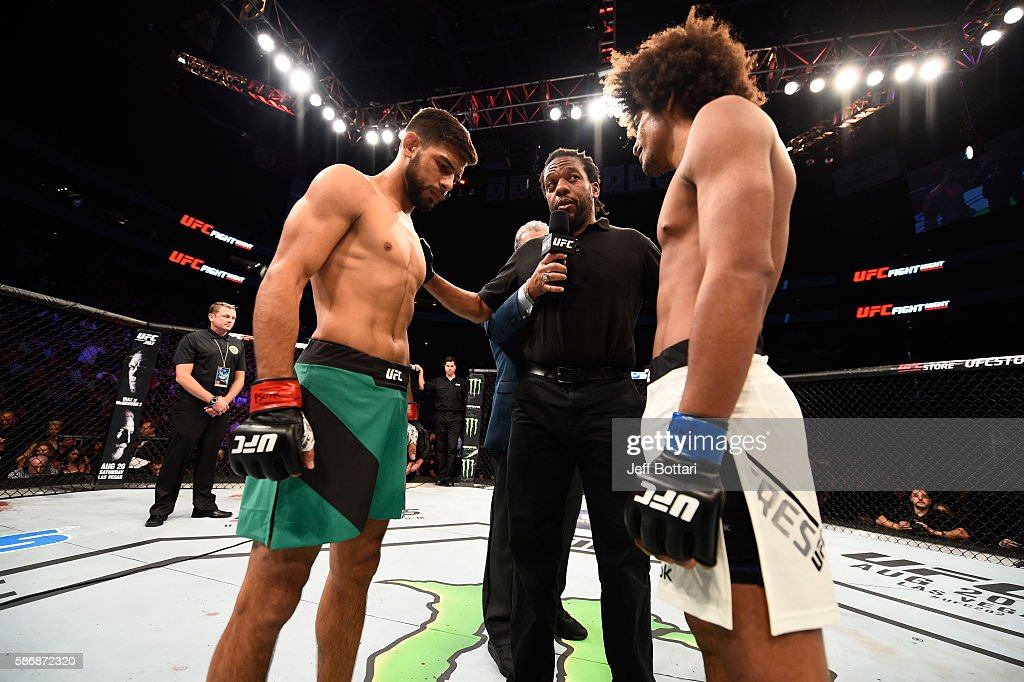 Yair Rodriguez of Mexico and Alex Caceres face off before the start of their featherweight bout during the UFC Fight Night event at Vivint Smart Home Arena on August 6, 2016 in Salt Lake City, Utah.