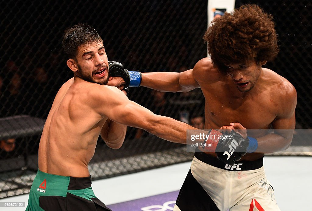 Yair Rodriguez of Mexico exchanges punches with Alex Caceres in their featherweight bout during the UFC Fight Night event at Vivint Smart Home Arena on August 6, 2016 in Salt Lake City, Utah.