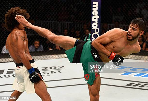 Yair Rodriguez of Mexico kicks Alex Caceres in their featherweight bout during the UFC Fight Night event at Vivint Smart Home Arena on August 6 2016...