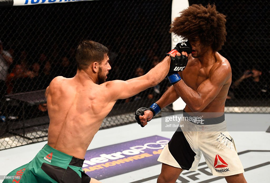 Yair Rodriguez of Mexico punches Alex Caceres in their featherweight bout during the UFC Fight Night event at Vivint Smart Home Arena on August 6, 2016 in Salt Lake City, Utah.