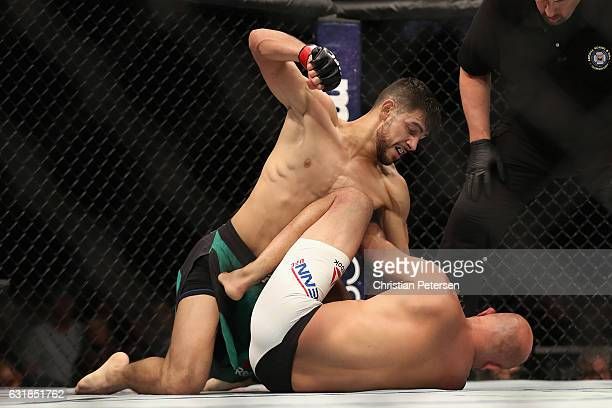 Yair Rodriguez punches BJ Penn during the UFC Fight Night event at the at Talking Stick Resort Arena on January 15 2017 in Phoenix Arizona