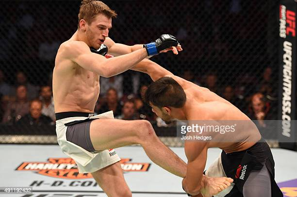 Yair Rodriguez punches Dan Hooker in their featherweight bout during the UFC 192 event at the Toyota Center on October 3 2015 in Houston Texas
