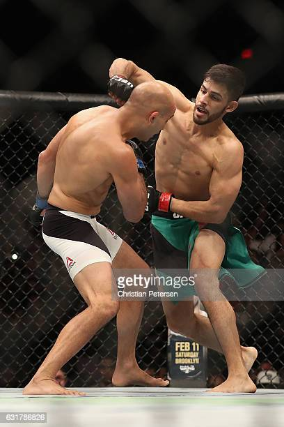 Yair Rodriguez throws a right on BJ Penn during the UFC Fight Night event at the at Talking Stick Resort Arena on January 15 2017 in Phoenix Arizona