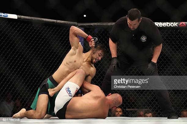 Yair Rodriguez throws a right onto BJ Penn during the UFC Fight Night event at the at Talking Stick Resort Arena on January 15 2017 in Phoenix Arizona