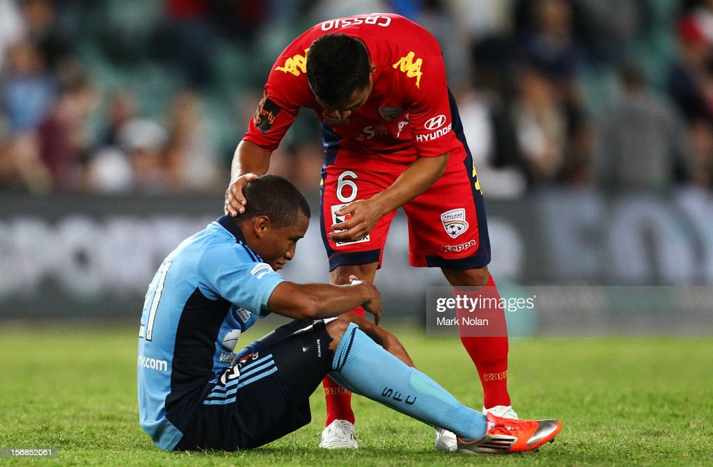 Yairo Yau of Sydney is consoled by Cassio of Adelaide after the round eight A-League match between Sydney FC and Adelaide United at Allianz Stadium on November 23, 2012 in Sydney, Australia.
