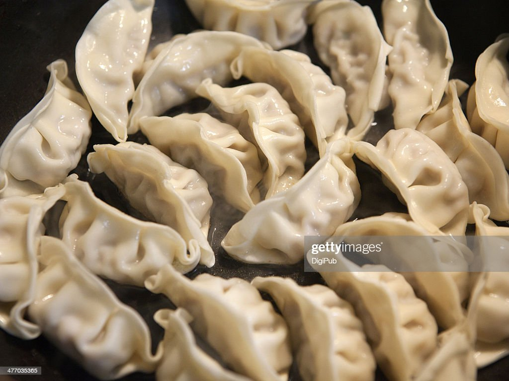 Yaki Gyoza being prepared : Stock Photo