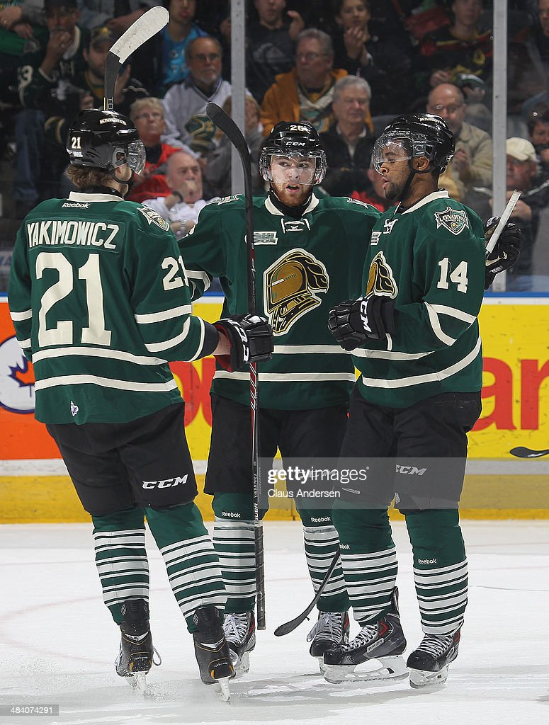 CJ Yakimowicz #21, Tait Seguin #26, and Gemel Smith #14 of the London Knights celebrate a goal against the Guelph Storm in Game Four of the OHL Western Conference Semi Final at Budweiser Gardens on April 10, 2014 in London, Ontario, Canada. The Storm defeated the Knights 6-3 to take a 3-1 series lead.