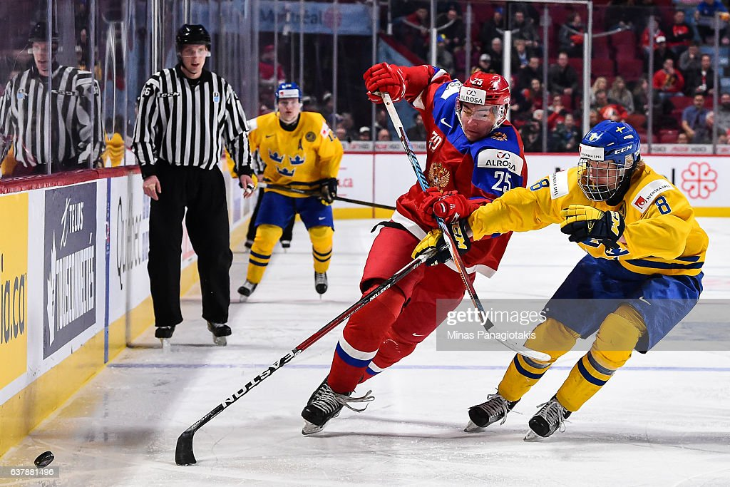 Yakov Trenin #25 of Team Russia and Rasmus Dahlin #8 of Team Sweden skate after the puck during the 2017 IIHF World Junior Championship bronze medal game at the Bell Centre on January 5, 2017 in Montreal, Quebec, Canada. Team Russia defeated Team Sweden 2-1 in overtime and win the bronze medal.