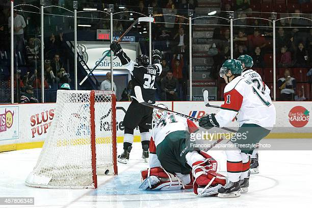 Yakov Trenin of the Gatineau Olympiques celebrates his second period goal against Zachary Fucale of the Halifax Mooseheads on October 24 2014 at...
