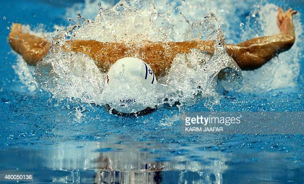 Yakov Yan Toumarkin of Israel competes in the Men's 100m Individual Medley semifinal during the 12th FINA World Swimming Championships in Doha on...