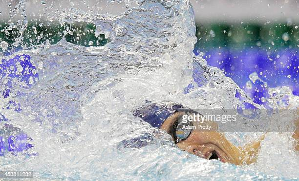 Yakov Yan Toumarkin swims the Men's 200m medley heats during the 32nd LEN European Swimming Championships at EuropaSportpark on August 19 2014 in...