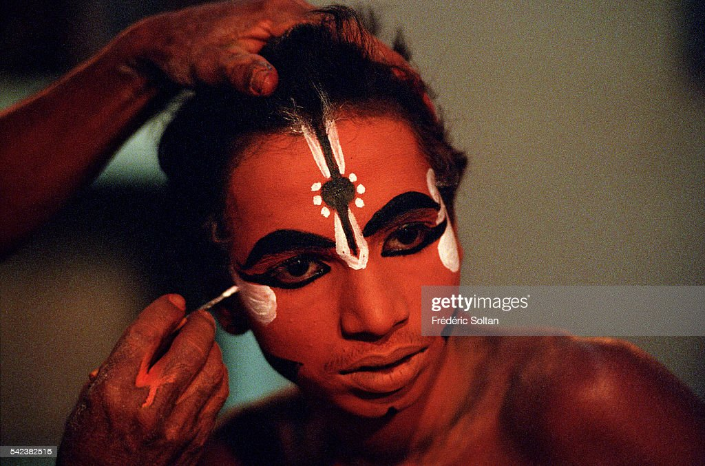 Yakshagana is a classical folk art a form of theater mixing music dance and dialoge Portrait of Arjuna a young artist during a makeup application