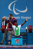 Yakubu Adesokan of Nigeria celebrates setting a new world record and gold in the Men's 48kg Powerlifting on day 1 of the London 2012 Paralympic Games...