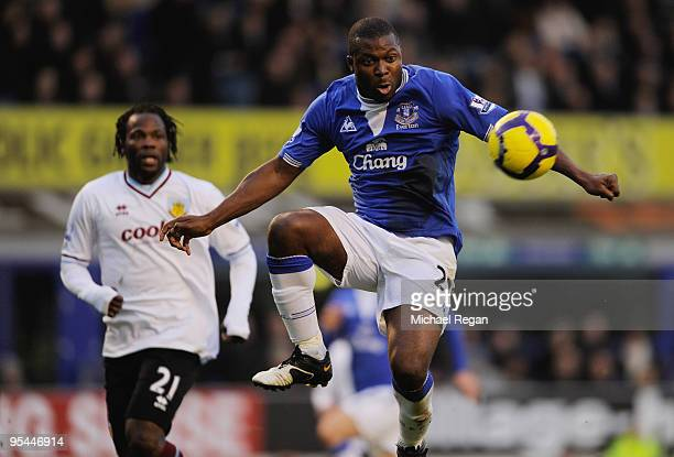 Yakubu of Everton controls the ball ahead of Andre Bikey of Burnley during the Barclays Premier League match between Everton and Burnley at Goodison...