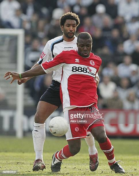 Yakubu of Middlesbrough shields the ball from Youl Mawene of Preston North End during the FA Cup Fifth Round match between Preston North End and...