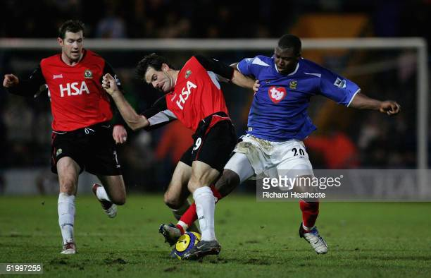 Yakubu of Portsmouth is tackled by Ryan Nelsen of Blackburn during the FA Barclays Premiership match between Portsmouth and Blackburn Rovers held at...