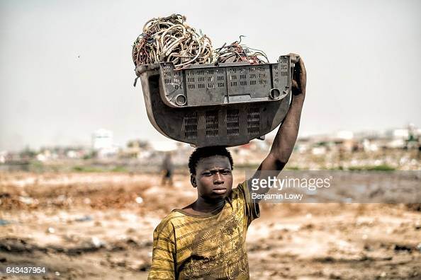 Yakubu Tanko carries the shell of a TV filled with computer and electrical wires on his head All these parts are destined to the Agbogbloshie burn...