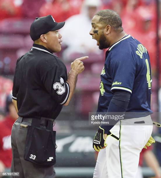 Yakult Swallows outfielder Wladimir Balentien is ejected by home plate umpire Hideto Fuke after striking out in the first inning against the...