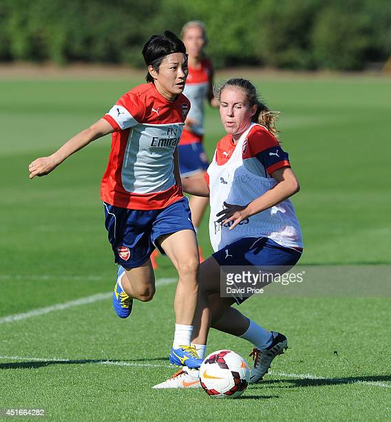 Yakuri Kinga and Ashley Goddard of Arsenal Ladies during their training session at London Colney on July 3 2014 in St Albans England