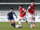 Yakuri Kinga of Arsenal Ladies is pressured by Melissa Lawley of Birmingham during the match between Arsenal Ladies and Birmingham City Ladies in the...