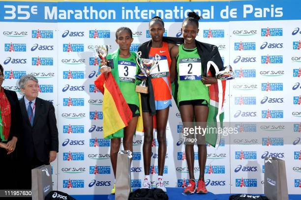 Yal Koren of Ethiopia Jeptoo Priscah of Kenya and Kiprop Agnes pose on the podium after the 35th Paris Marathon on April 10 2011 in Paris France