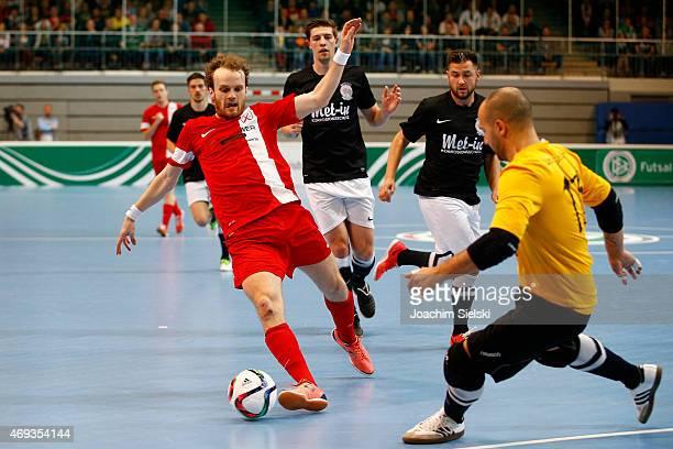 Yalcin Ceylani of Hamburg challenges Stephan Kleine of Schwerte during the DFB Futsal Cup Final between Holzpfosten Schwerte and Hamburg Panthers at...